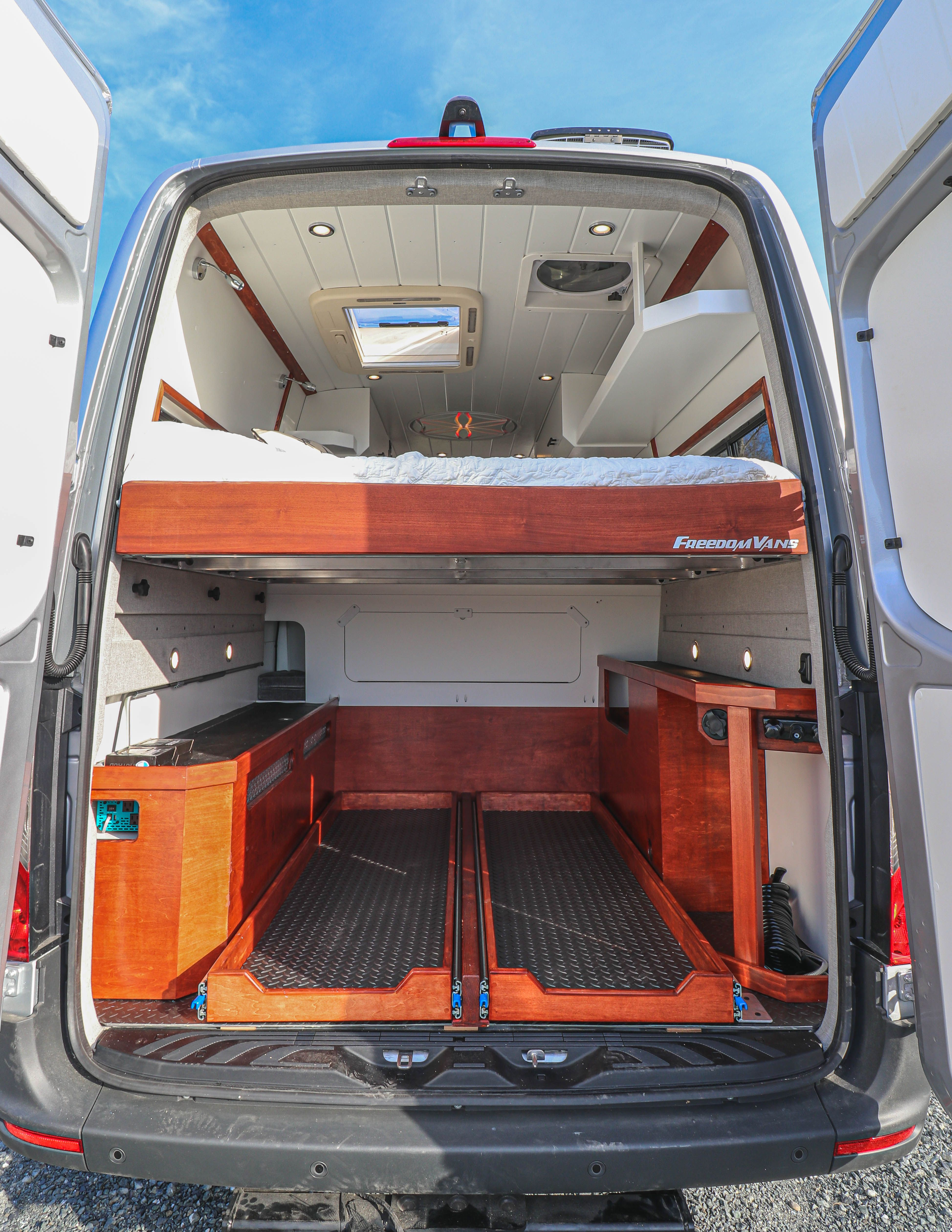 More photos and a tour video of this van conversion can be found on the project gallery of our website! #vans #freedomvans #sprinter #sprinterconversion #homeonwheels #smallspaceorganization #garage #tinyhome #tinyhouse #tinyliving #homeonwheels #vanconversion #convertedvan #convertedsprinter #vanconversioncompany #bellingham #washington