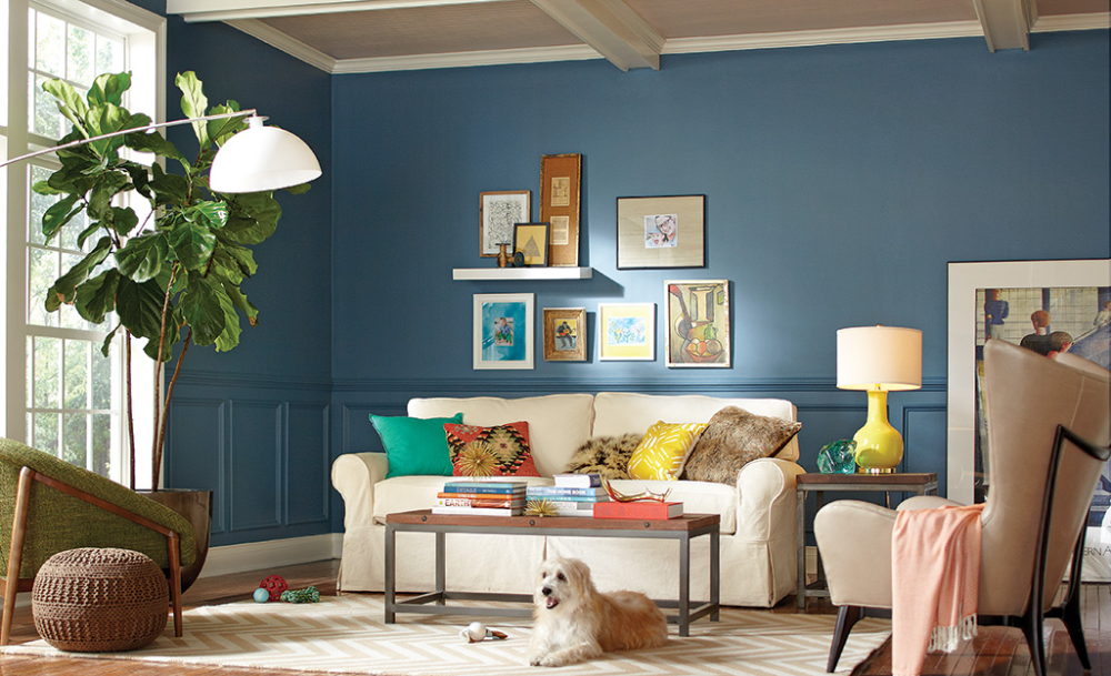 A Peacock Blue Accent Wall Is The Backdrop For A Boho Inspired Living Room In 2020 Blue Living Room Light Blue Living Room Blue Walls Living Room