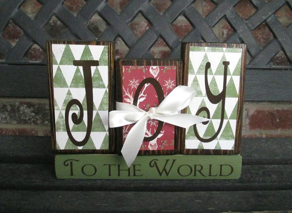 These blocks are so fun! PERFECT for Christmas!    Blocks are stained with Christmas themed paper applied in shades of deep red, cream and avocado. The