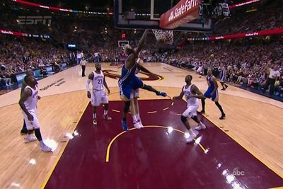 Festus Ezeli slams down a ridiculous tip dunk while being tackled by Timofey Mozgov