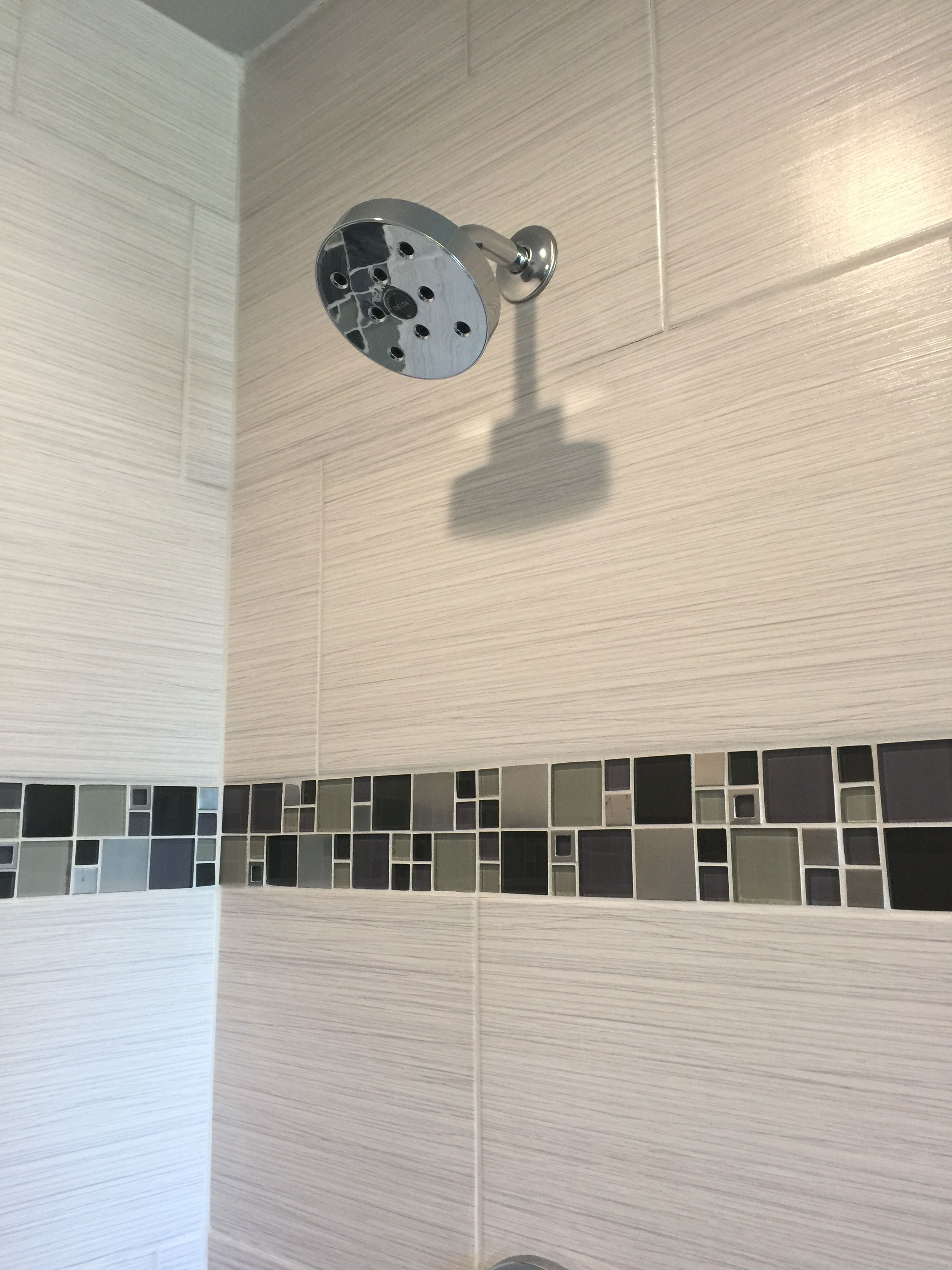 Custom Tiled Shower With 12x24 Satiated Tile Run 1 3 Staggered Vertically With A Glass And Metal Mosaic Accent Stri Custom Tile Shower Shower Tile Custom Tiles