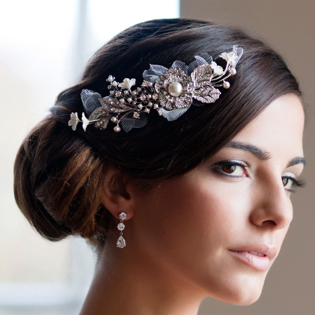 Our Floral Enchantment Headpiece by Glitzy Secrets is perfect for brides who adore elegance. Browse online for bridal hair flowers.