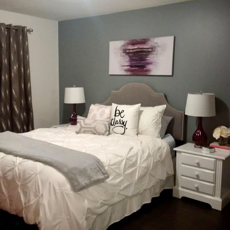 The Master Bedroom Has A Deep Charcoal Accent Wall To Add Some Drama To The  Room. The Clean White Bedding Looks So Bright And Clean In This Room. The  Purple ...