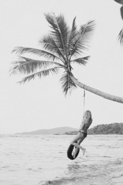 (Small BW) by admino Tire over the water hanging by a palm