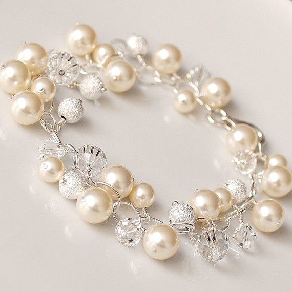 And this! Pearl Cluster Bracelet Ivory Pearl and Crystal by somethingjeweled, $85.00