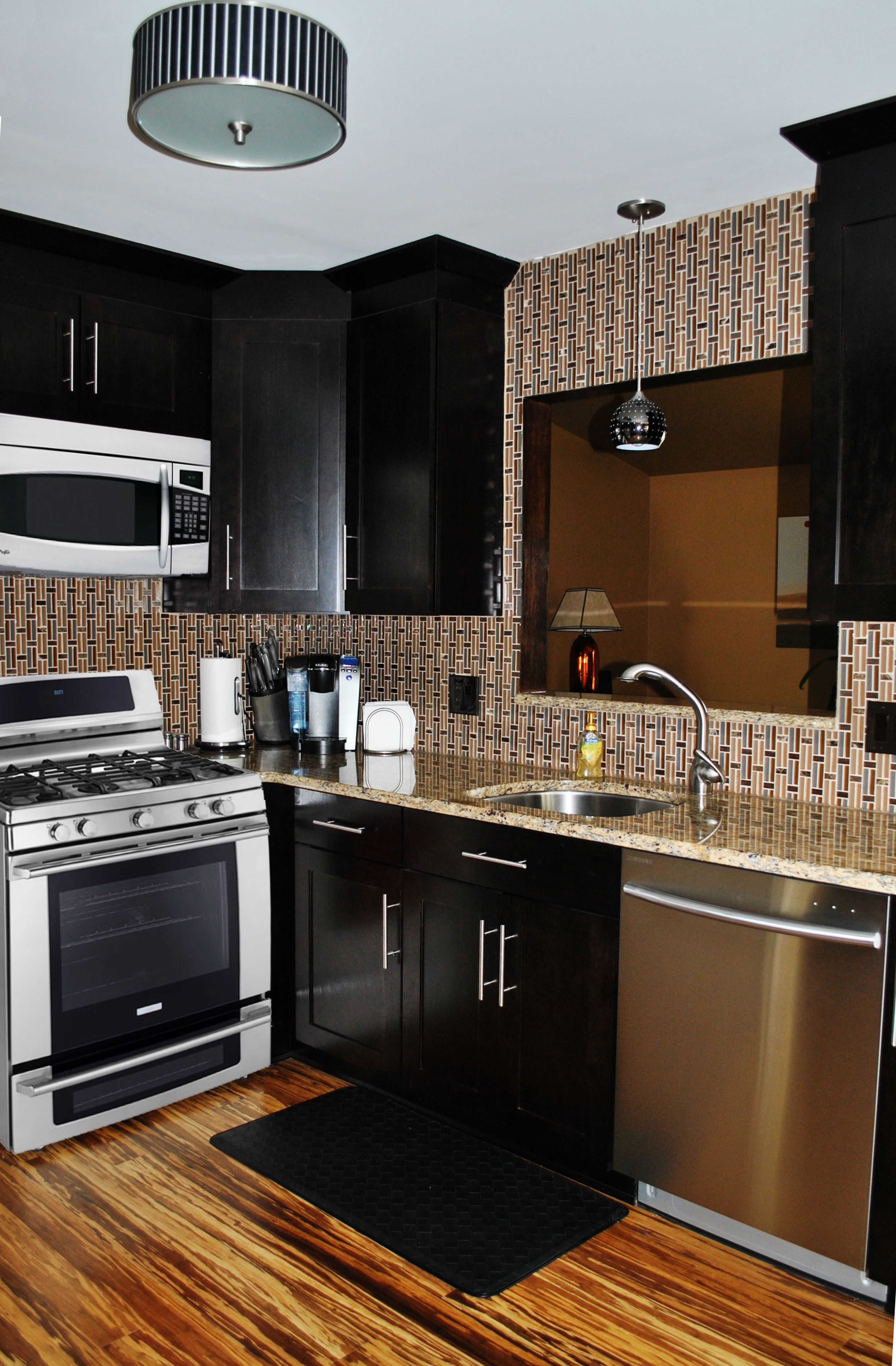Tile flooring for kitchen  Dark Contemporary Cabinetry with Granite Countertop White