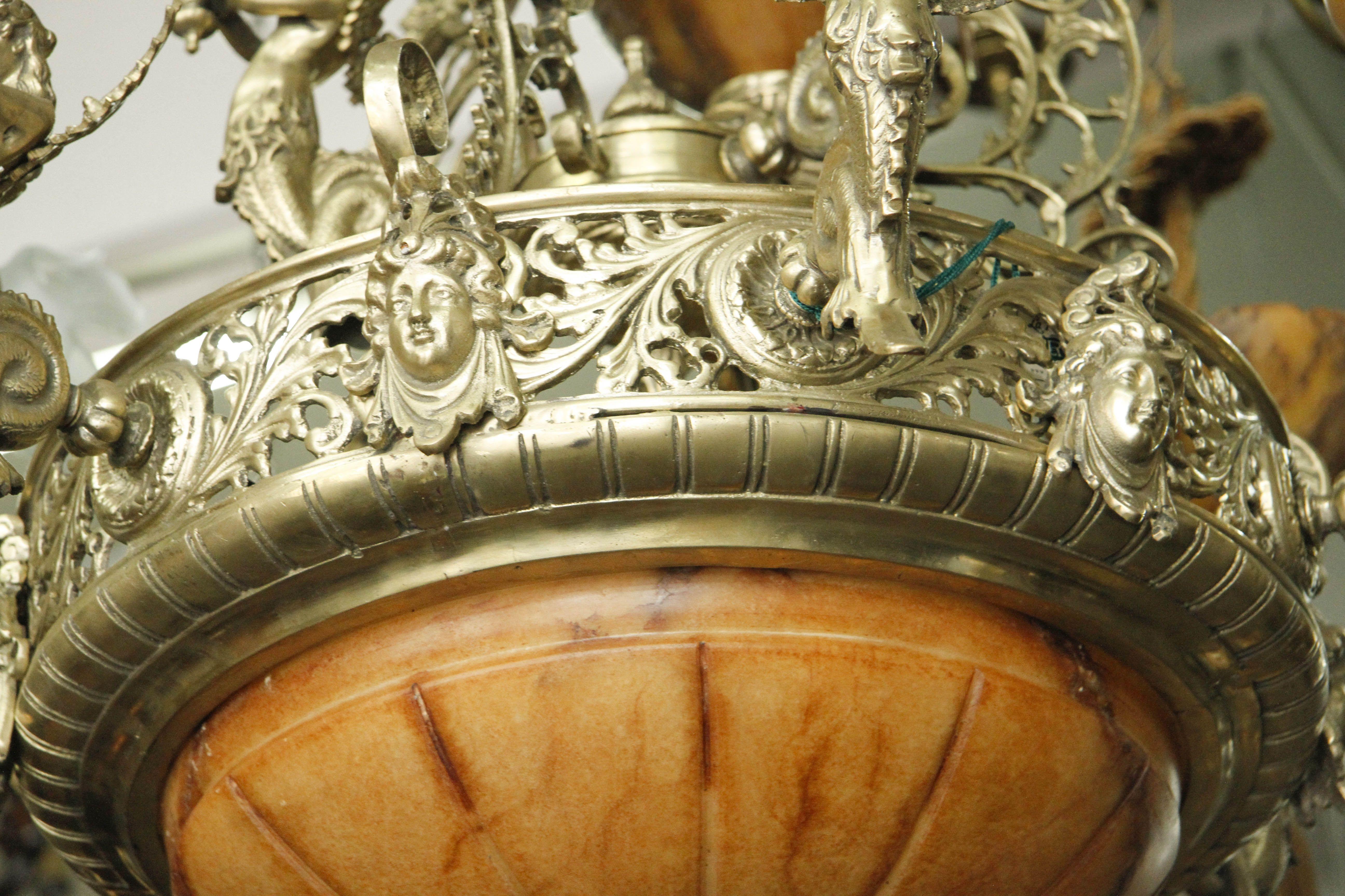 Araña de bronce con tulipas de Alabastro. 9 luces www.larueda.com