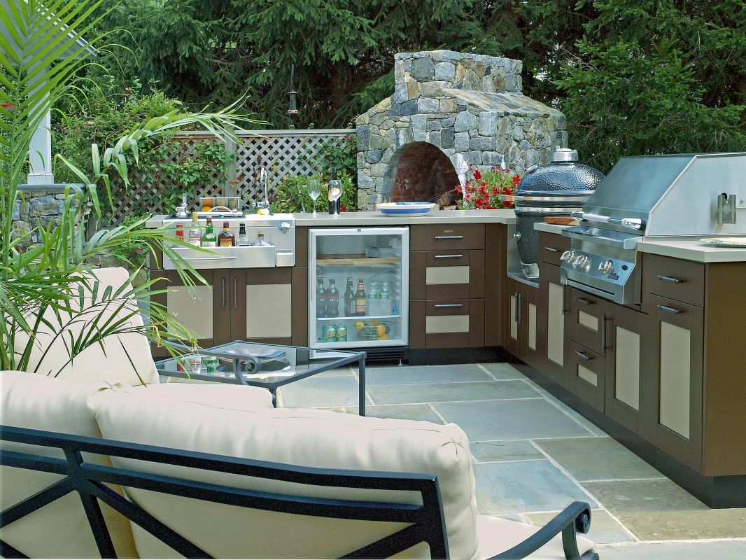 Danver Stainless Steel Outdoor Kitchen Cabinets In A Painted Finish And  Cushioned Outdoor Seating Bring The