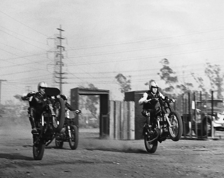 Evel knievel left and his first daredevil show 1966