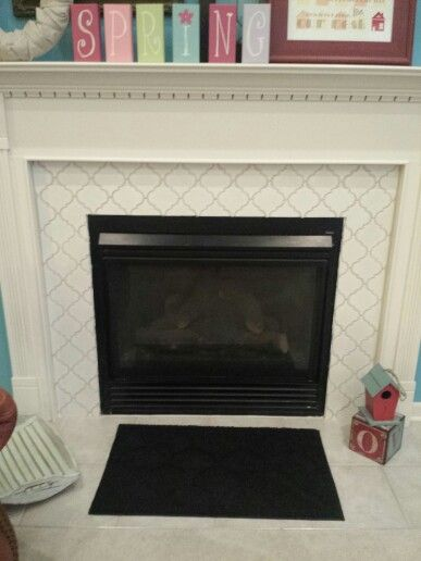 My revamped fireplace! I tiled over the builder grade tiles with ...