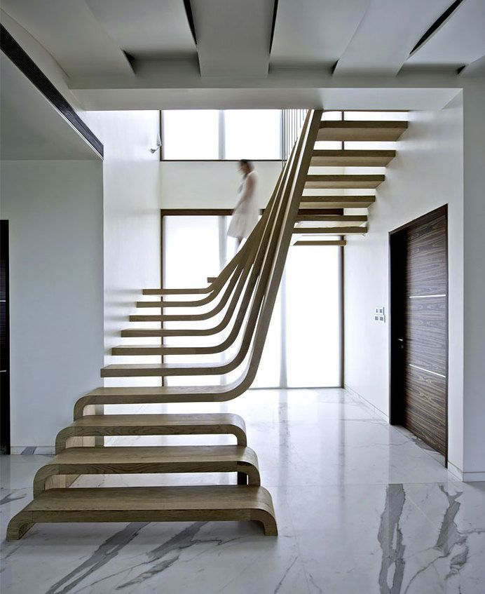 Sophisticated indian apartment with woven staircase for Interior staircase designs india