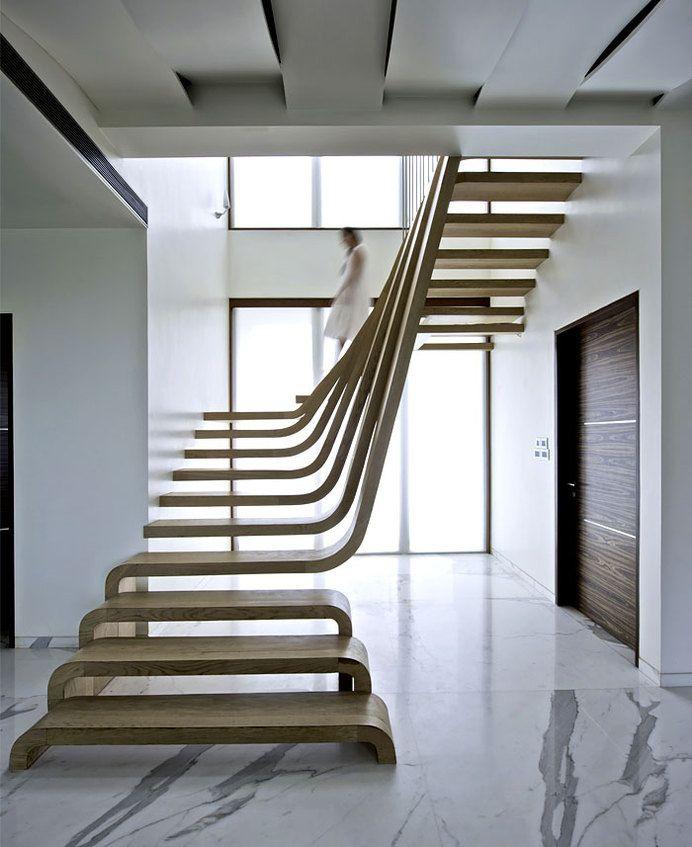Sophisticated indian apartment with woven staircase central focal art point wooden arabescato marble flooring in also escalera futurista  elegante para viviendas con mucho estilo rh pinterest