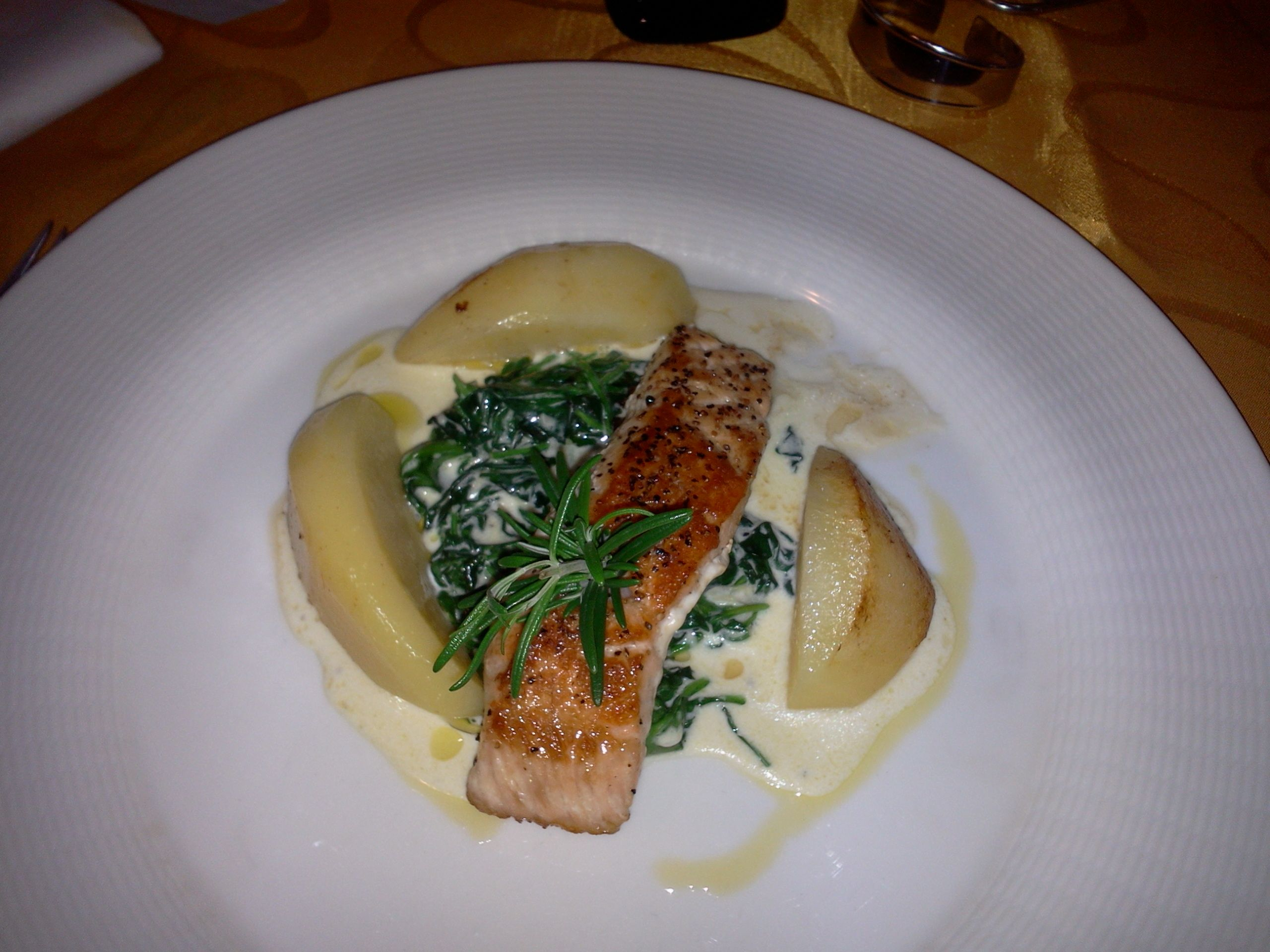 Grilled Salmon Filet Served On Cream Leaf Spinach Buttery Potatoes