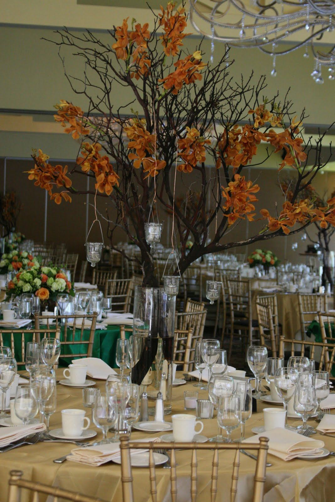 Manzanita branch centerpieces with a different flower since the wedding centerpieces junglespirit Images