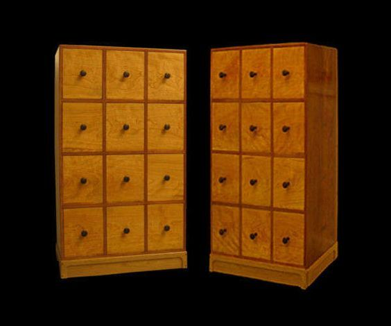 This design comes from furniture maker Stan Pike, http://www.stanpikedesigns.com and features some nice touches like dovetail joints on the bins.  Not with this design, the face of each bin fits inside the walls of each shelf (like classic apothecary cabinets).