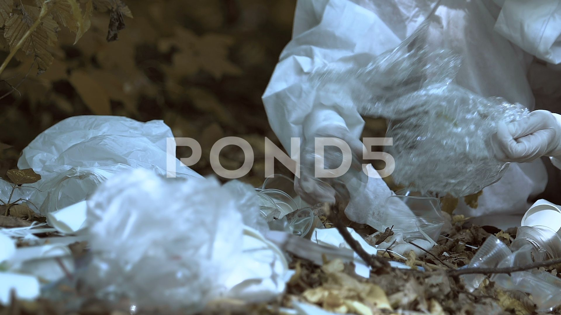 Lab assistant analyzing plastic waste in forest toxic harmful effect on nature Stock Footage plasticwasteforestLab