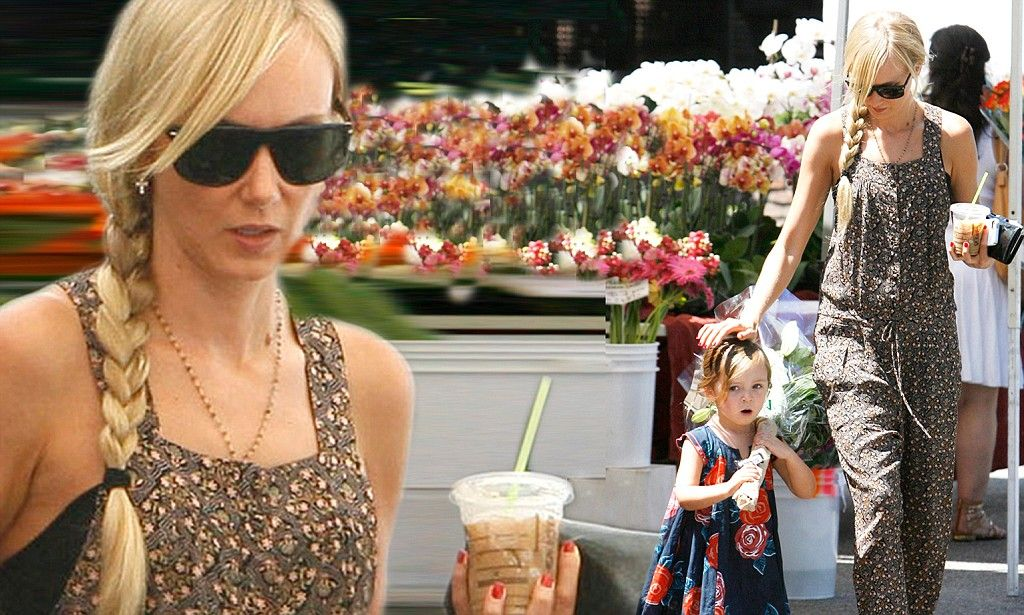 Kimberly Stewart displays thin pins in summery frock for 4th of july