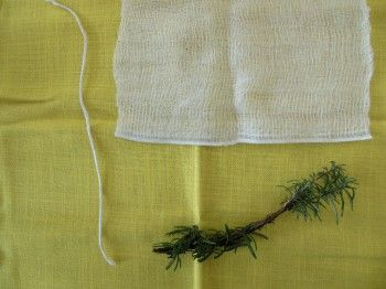 a sprig of rosemary a piece of string and a square of cheese cloth