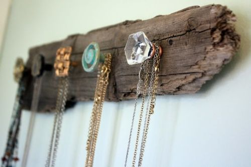 reclaimed wood + knobs for necklace storage.