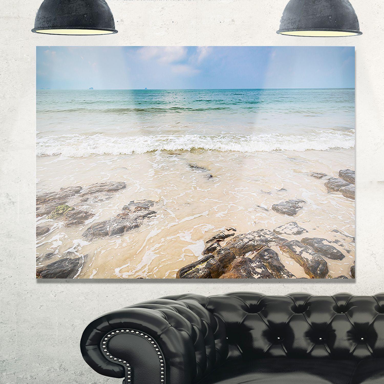 Rocks on typical tropical beach beach glossy metal wall art