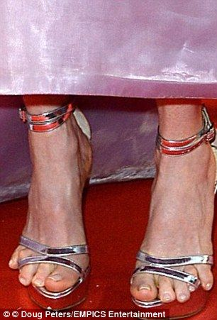da8f66f164 Bizarre pictures show Spanish mayor's toes sticking out from her shoes