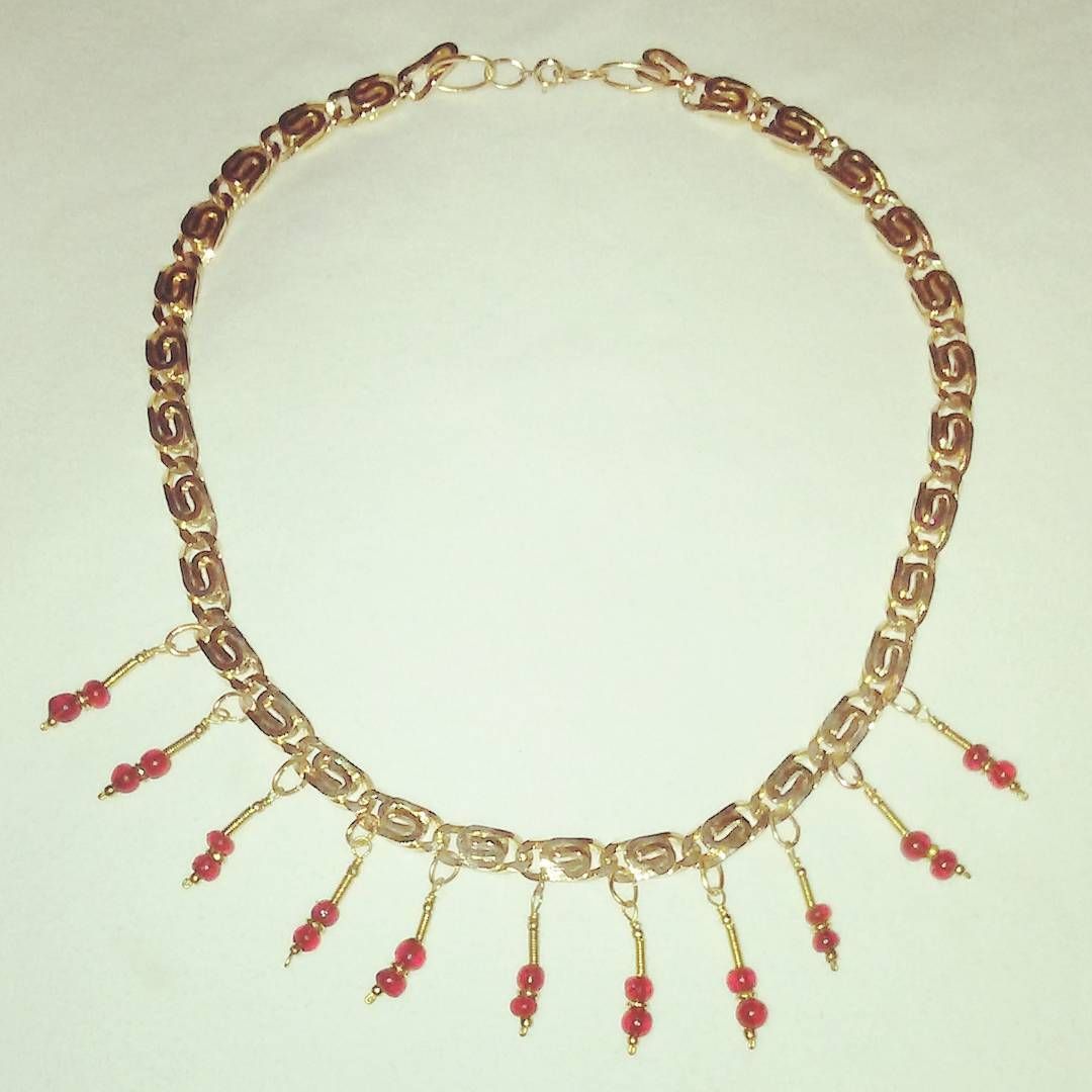 Fancy chain gold collar necklace with wire embellished dark red beads #goldjewelry #redglass #wirework #india #collarnecklace #jeweltones #texasmade #texasgirl #texasstyle #madeintexas #handmadejewelry #customjewelry #dallas #dallasartist #dfwartist #amandanancedesigns