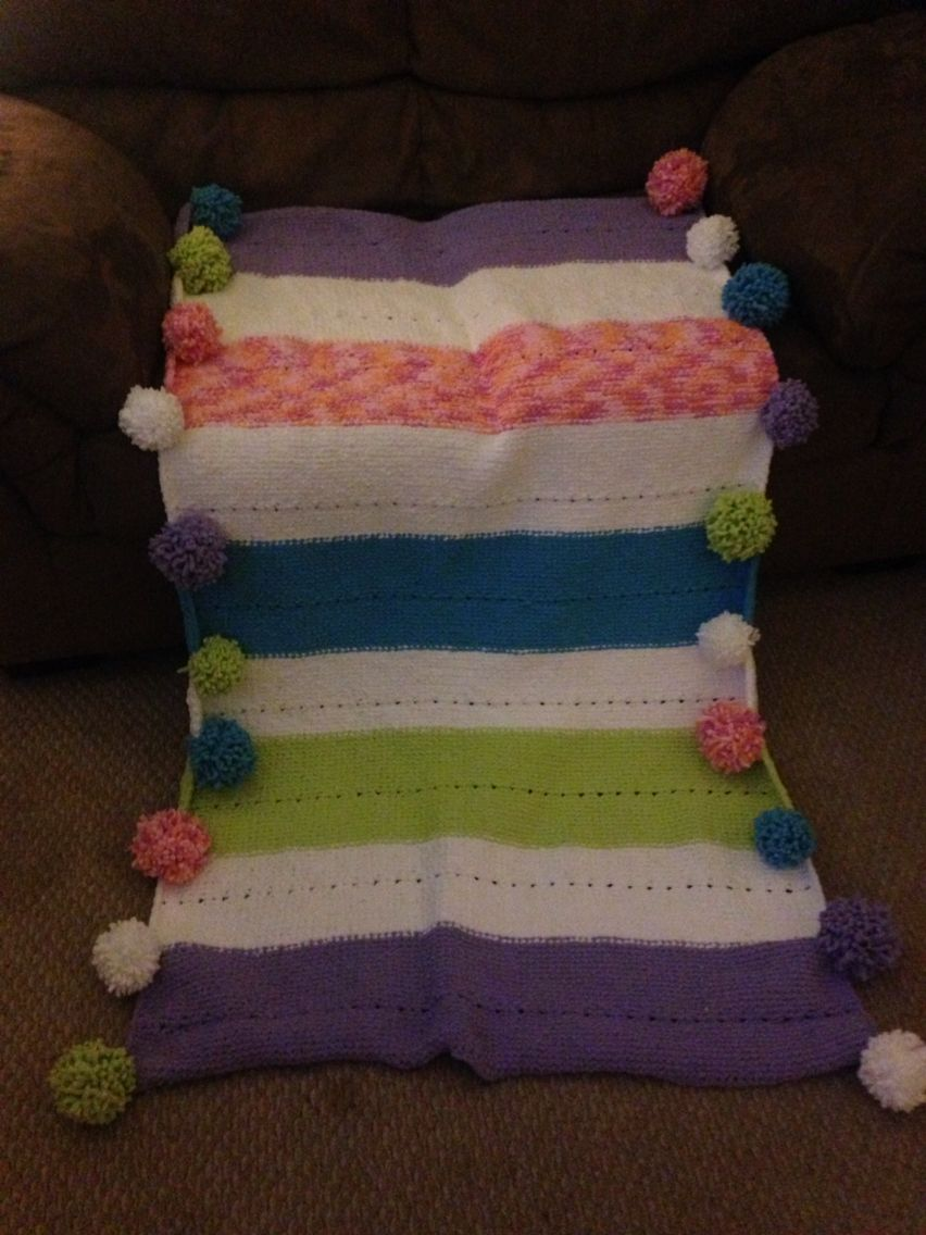 Loom knit blanket with Pom poms