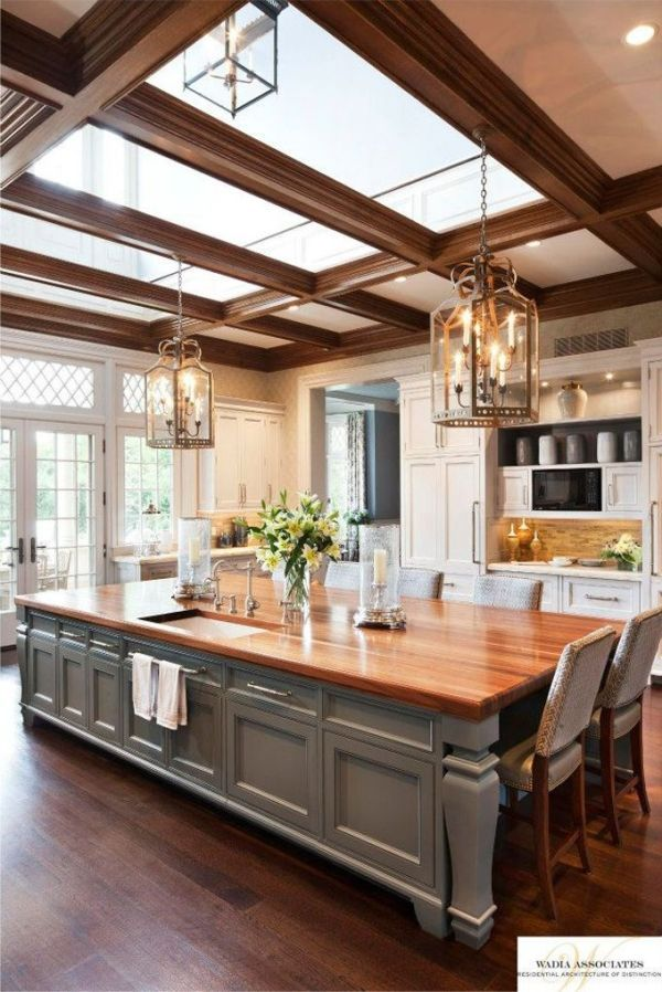 Splendid oversized island with butcher block top and skylights above