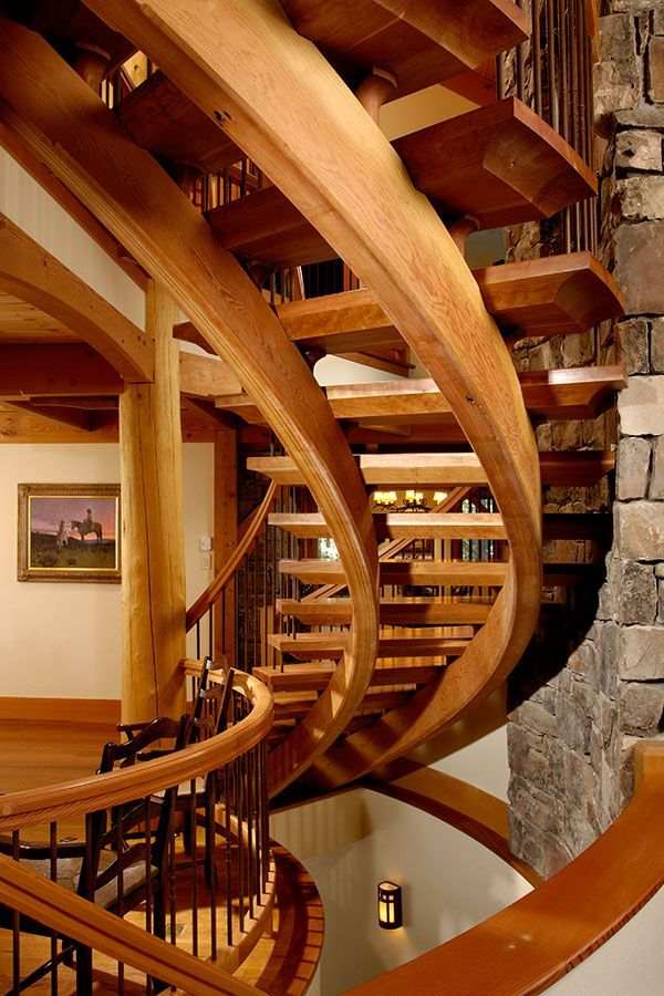 Dramatic spiral staircase in Wyoming timberframe home ...