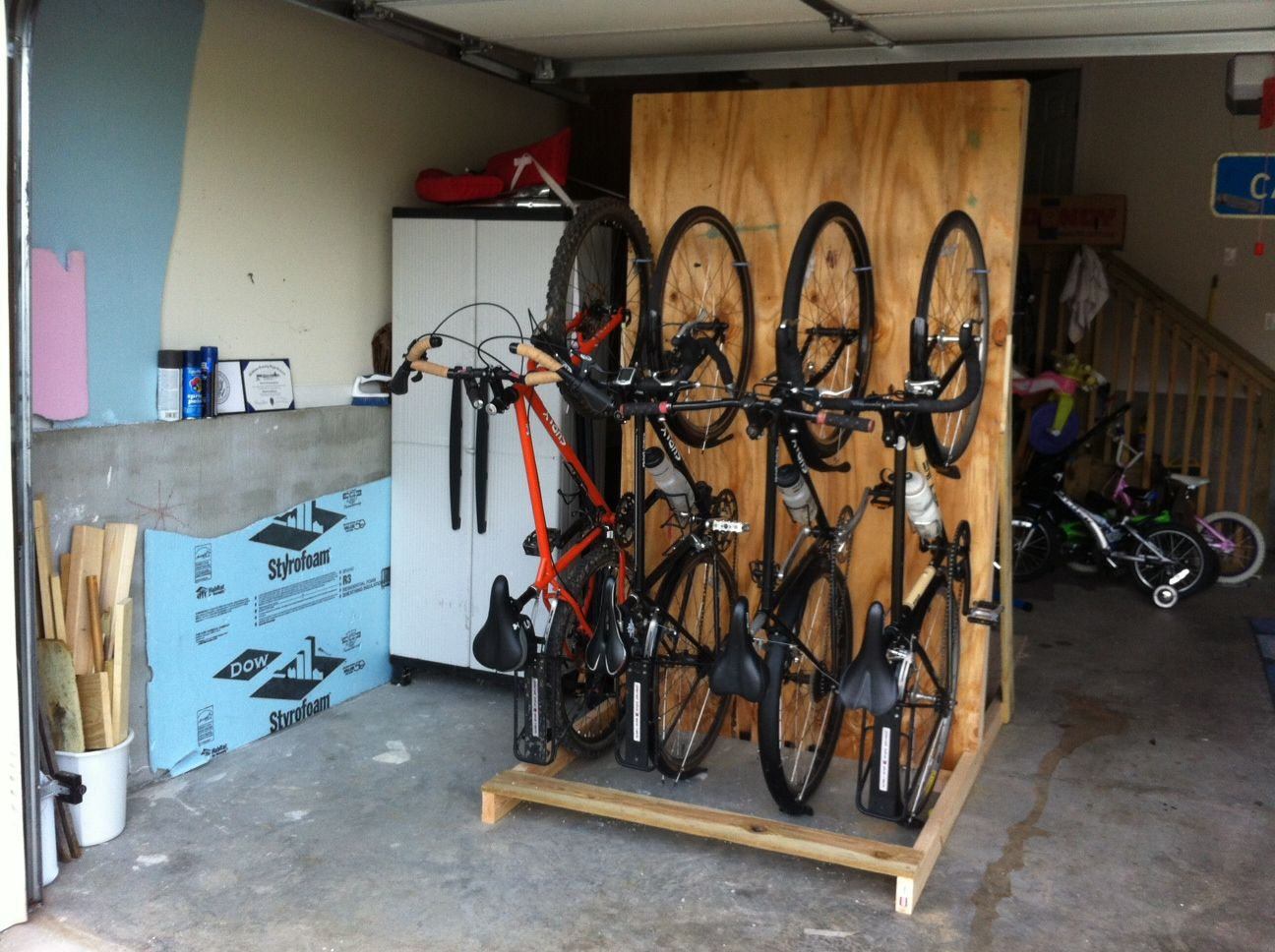 family bike words bike parking made it with pallets house design country vertical bike storage ideas with teak wood bike hangers also concrete tile floor and colorful wall painted for youngster bike storage