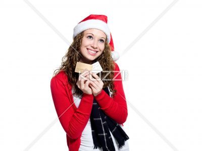 thoughtful young woman holding credit cards. - Thoughtful young woman holding credit cards against white background, Model: Brittany Beaudoin