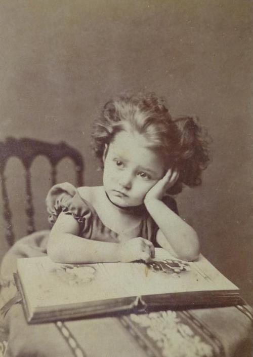 Girl with photo album - c. 1870s