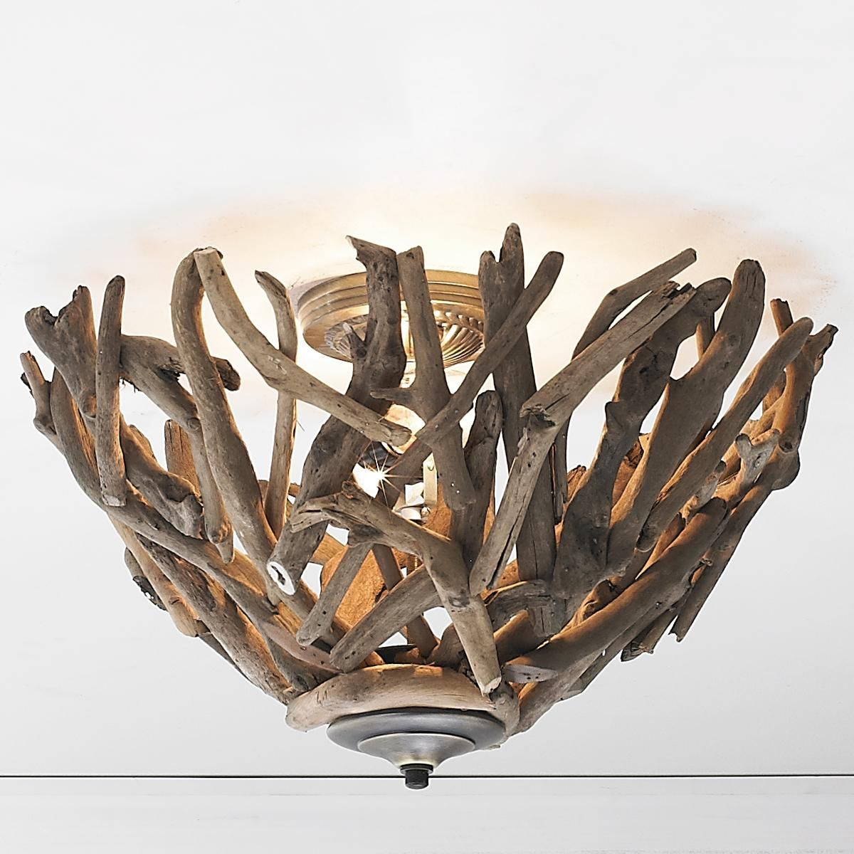 Reclaimed Driftwood Basket Ceiling Light Abstract driftwood bowl serves as sculpture for your ceiling, casting entrancing patterns of light all over the room.