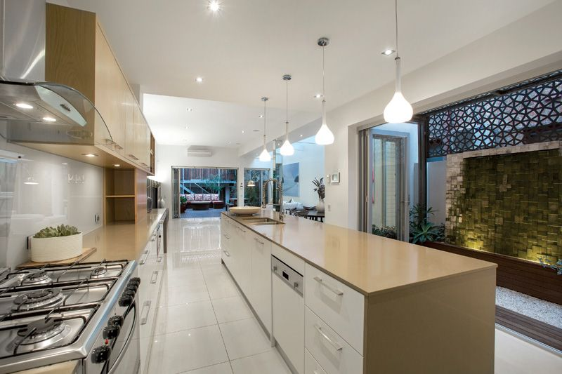 A state-of-the-art kitchen featuring Gaggenau appliances and Wesco ...