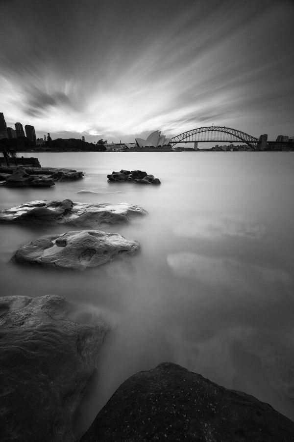Sydney opera house and the harbour bridge shot at botanical garden.