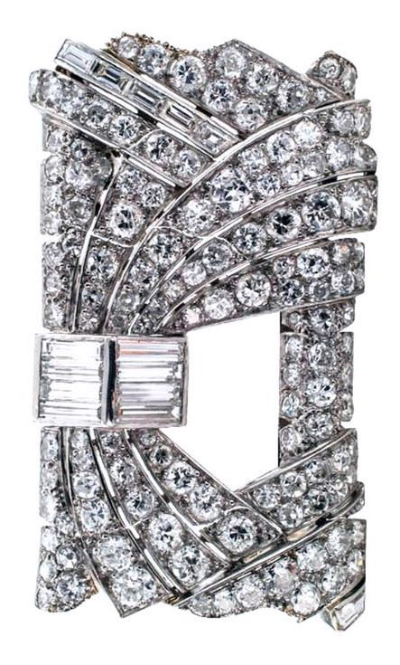 "Art Deco French Diamond Rectangular Brooch. This unique French Art Deco design is composed by a bold rectangular motif filled with courses of round diamonds gently cascading around a central opening juxtapositioned with baguette diamond motifs, the look is tres avant-garde, 100% Diva. There are One hundred forty-six glittering diamonds that total approximately 10.00 carats, mounted in platinum, French hallmarks, dimensions: 1 3/4"" X 1 1/8"" overall. Circa 1930's"