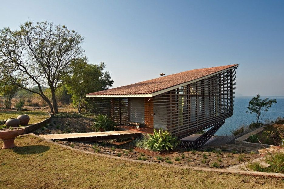 Elegant Beautiful Over Water House Building Designed With Cool Wooden Home Concept  With Asymmetric Roof Idea