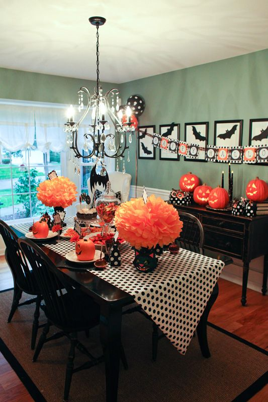 Halloween table-   Black and white runner on my black table with orange flowers- easy and festive!  www.schoolgirlstyle.com