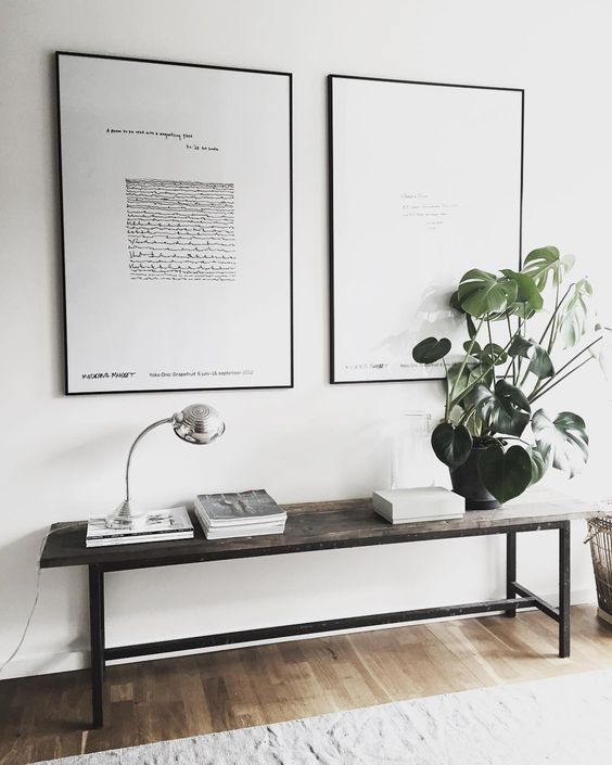 A Scandinavian Entryway With A Reclaimed Wooden Bench And A Duo Of Black And White Artworks Minimalist Furniture Design Minimalist Furniture House Interior
