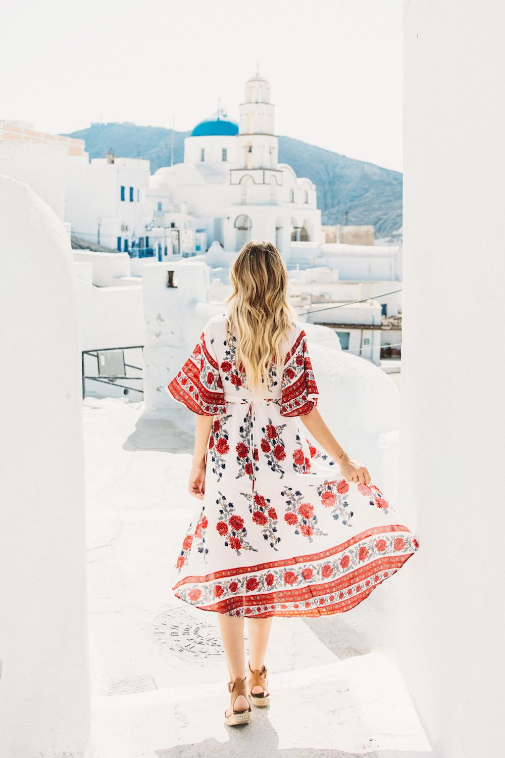 e9ca549464f2 Dash of Darling shares her travels to Santorini, Greece with Royal  Caribbean Cruises while wearing a Reverse dress from Revolve Clothing.