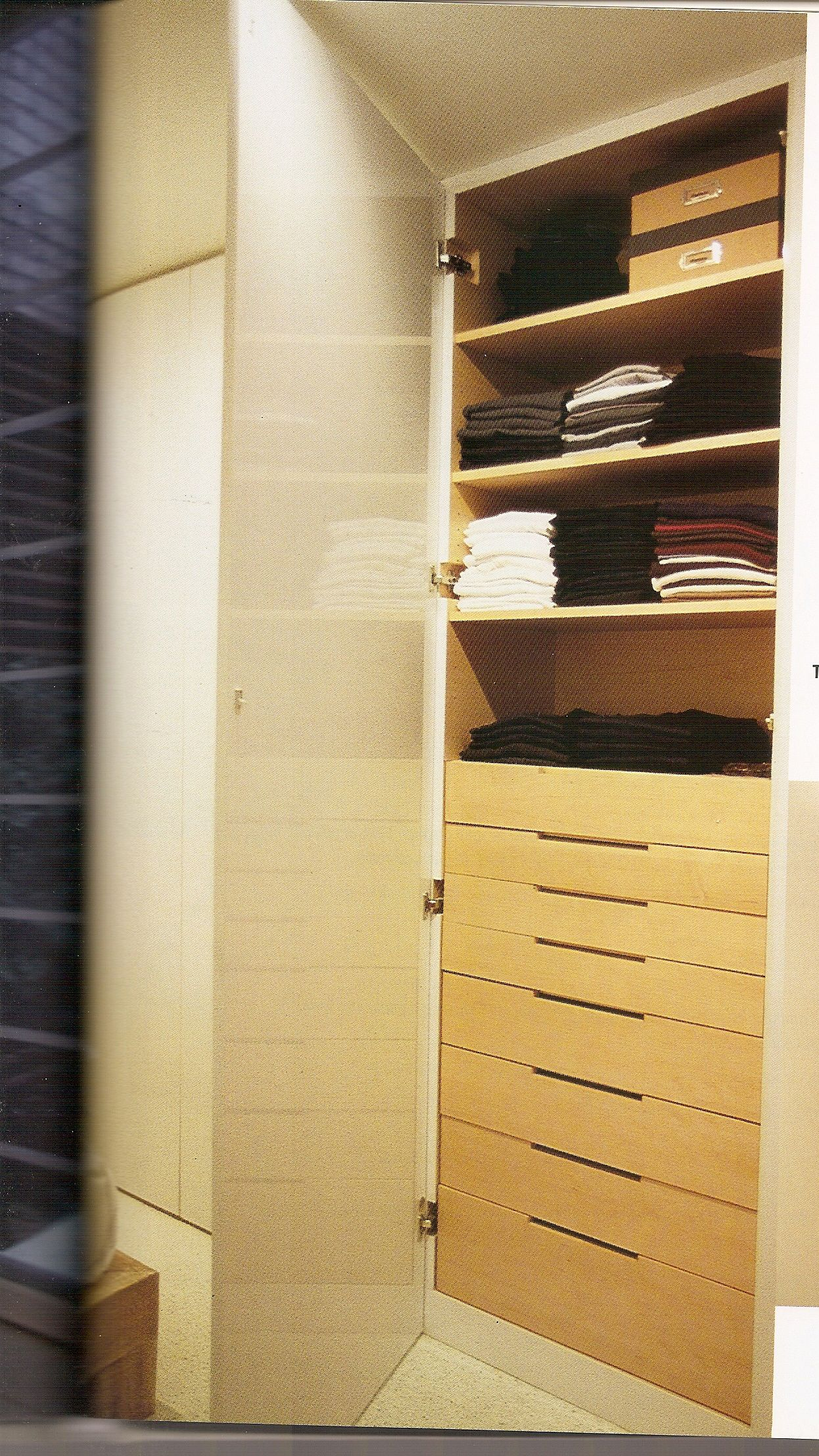 Take part of hanging closet and build in custom depth drawers use