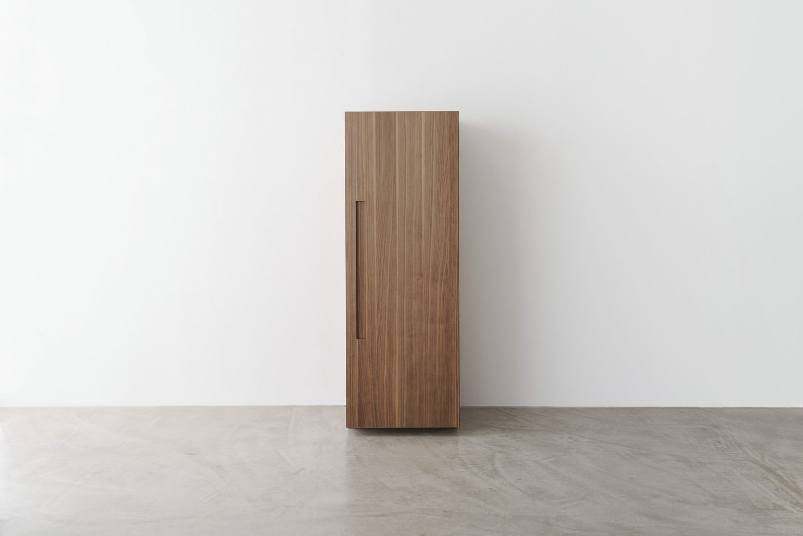 When closed, the kitchen tool cabinet has a sculptural presence in the room. Opening the doors gives the user a clear view of the essential kitchen tools.