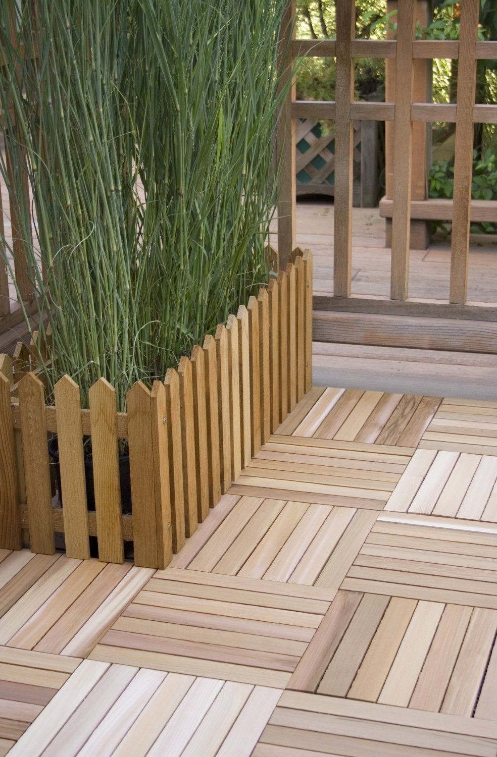 Deck Tiles  They can be used over concrete and directly over grass as long as level  Trellis