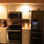 Remodeled Country Kitchen, painted cabinets, laminate floor, new backsplash