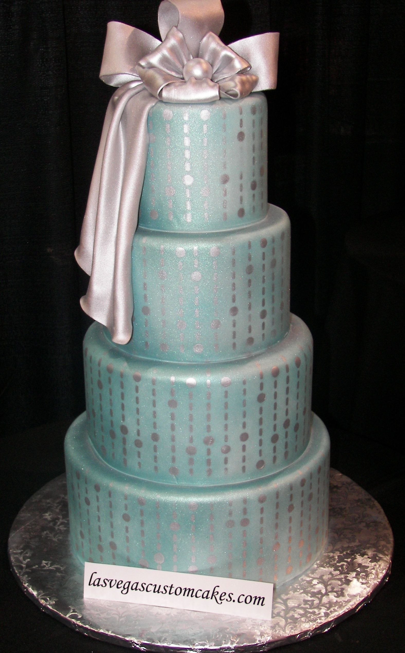pale teal cake with silver accents and bow