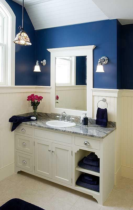 Loving the Navy Blue and beadboard combo- maybe in a shade of Royal blue though?