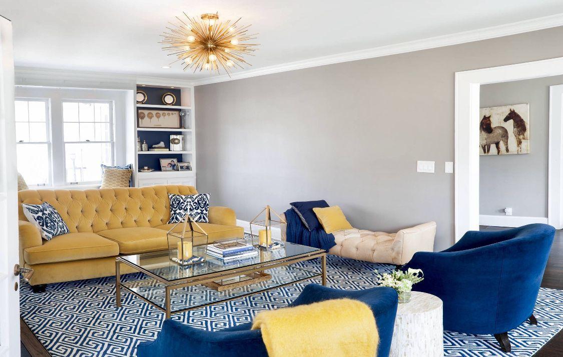 Canary yellow sofa, navy blue sofa, transitional living room, cozy