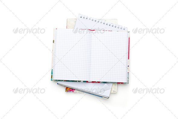 stack of some open blank note pads and books, isolated on white - collection note