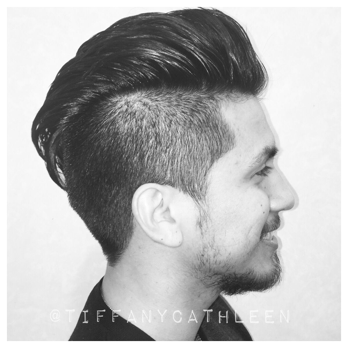 Modern men\'s hairstyle, a variation of the pompadour. Styled with a ...