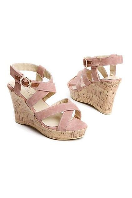 The wedges made of PU, featuring wrapped straps to upper, ankle strap fastening with pin buckle, vintage feel, rubber sole.